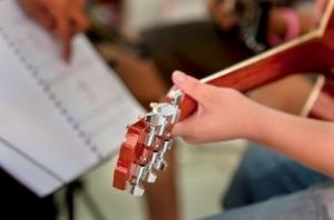 Teacher teaches guitar by worradmu Freedigitalphotos.net