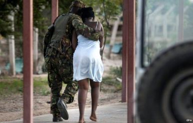 A terrified Kenyan student helped by a soldier. Image courtesy of BBC News.com