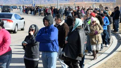People wait in line to purchase lottery tickets, January 9, 2016. Image courtesy of CBSNEWS