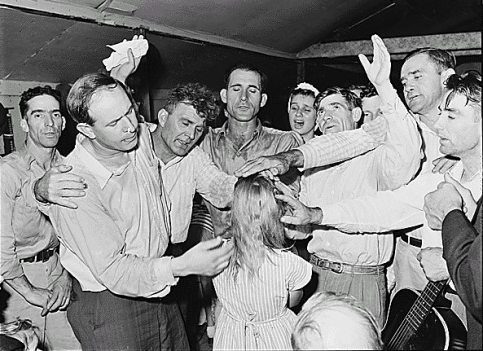 A 1946 laying on of hands at the Pentecostal Church of God. Image courtesy of wikipedia.org