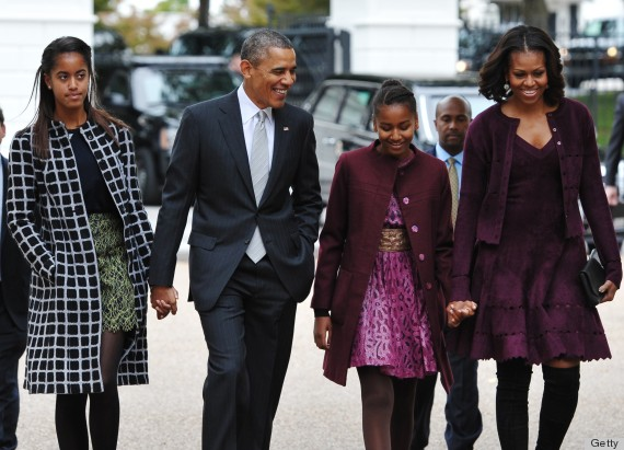 US President Barack Obama and First Lady Michelle Obama walk with daughters Malia (L) and Sasha (2nd R) across Lafayette Park to Saint John's Episcopal Chuch for Sunday services on October 27, 2013 in Washington, DC. AFP PHOTO/Mandel NGAN (Photo credit should read MANDEL NGAN/AFP/Getty Images)