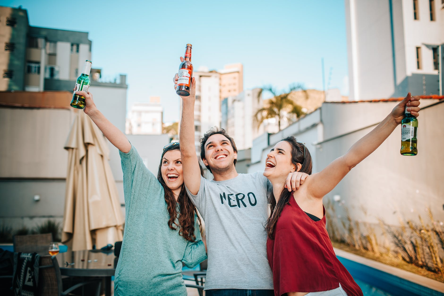 friends holding bottles of beer