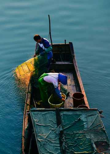 photo of fisherman on a boat