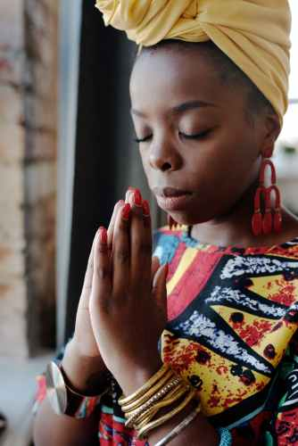 close up photo of woman praying