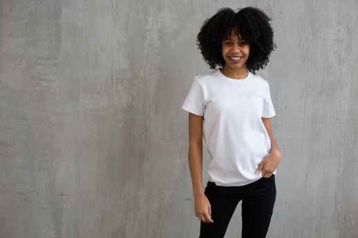 smiling black woman in white t shirt and pants
